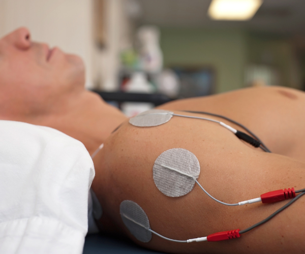 NMES passes safe electrical impulses through the affected area, stimulating and contracting the muscles and helping them work again.