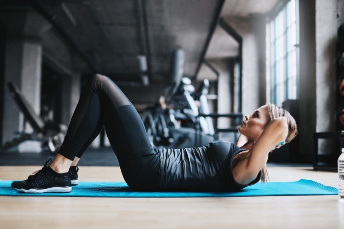 Partial crunches can help strengthen your back and stomach muscles.