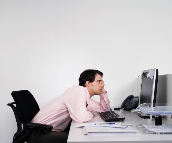 Slouching at your desk exacerbates low back pain.