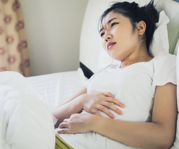 Constipation can cause a dull, achy pain in your lower back.