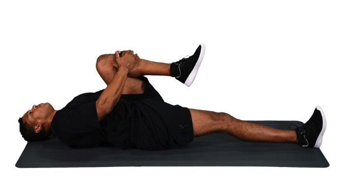 Doing a knee-to-chest stretch can help elongate the lower back and can relieve pain and reduce tension.