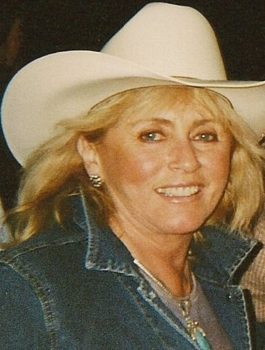cowgirl in white hat.jpg