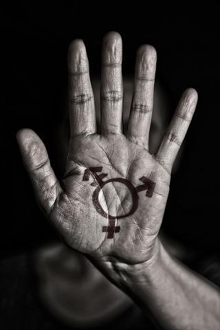 Canva - transgender symbol in the palm o