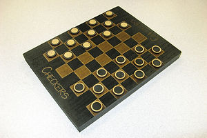 This checkers set was cut by the laser engraver/cutter.
