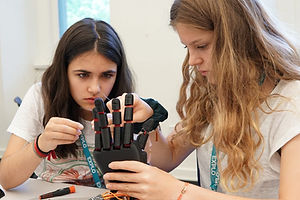 Students working with the NeuroMaker Hand