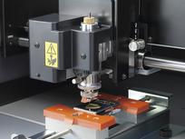 Roland DG DE-3 DGSHAPE desktop rotary engraver in action