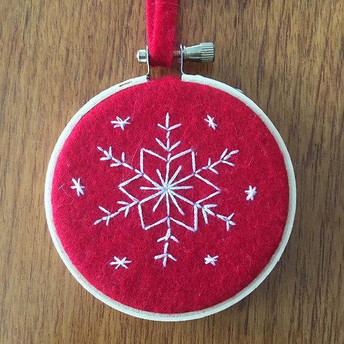 """Snowflake on red felt 3"""""""