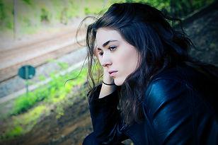 sad woman on train