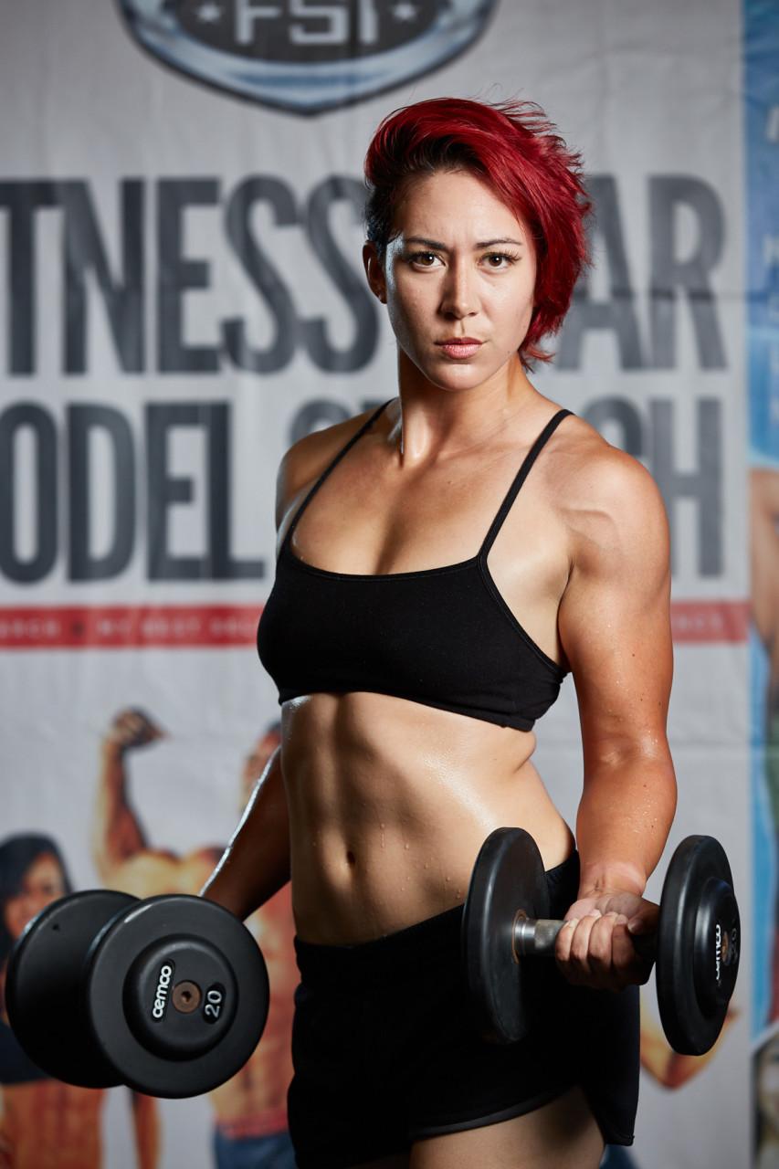 Fitness Model Biceps Dumbbells