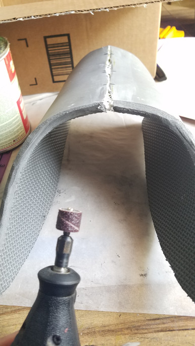 I used the sanding bit on my dremel to smooth out the edges of the armor.
