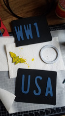 """Started painting the buckle with acrylics.  For the license plates, I googled """"license plate font"""", typed out what I wanted in word in the size I needed, then printed that out to use as my template. I transfered over to 2mm craft foam and used contact cement as the adhesive."""