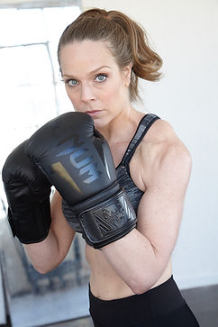 Mariette Booth Headshot boxing.jpg