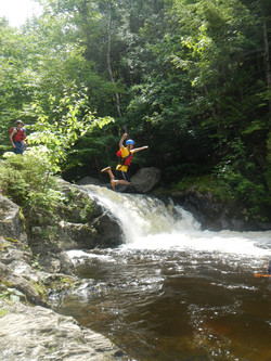 Jumping by a Waterfall