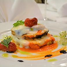 Mille feuilles d'aubergine avec tomates confites et crème de burrata