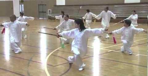 Group practicing sword thrust