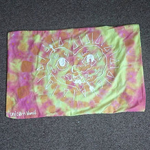 Tie-Dye flag with heart motif painted on with fabric paint