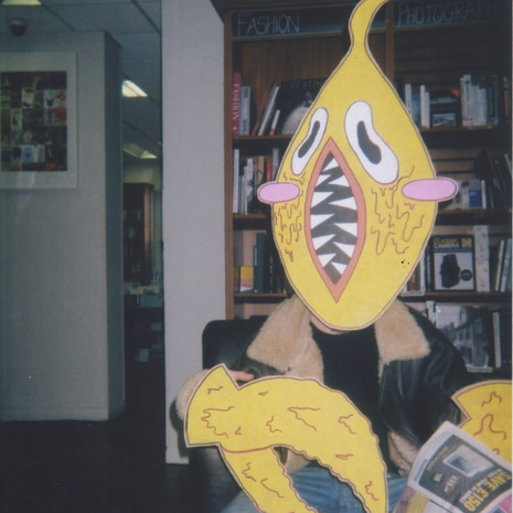 Painted cardboard mask and claws, modelled and photographed using a disposable camera