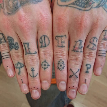 Handpoked lower knuckle tattoos