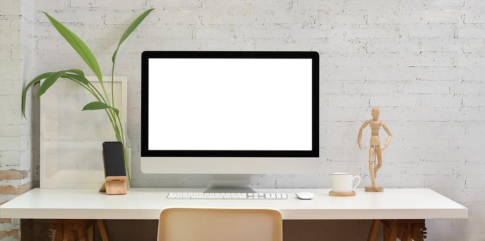 silver-imac-on-white-wooden-desk-3740288