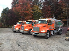 3 of our Curtiss Oil trucks