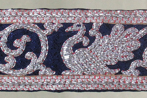 D-62Narrow densely embroidered strip in silver thread