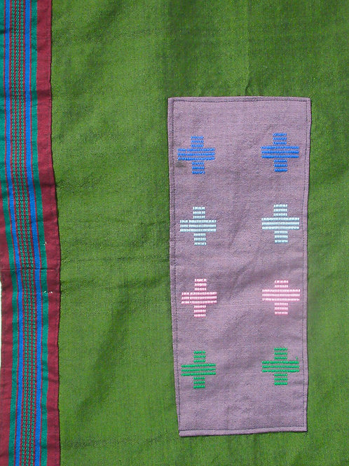 52. Medium green Shrug with backpanel wovenwith coloured crosses