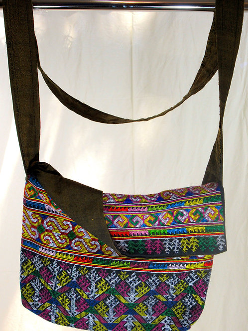 D-10 Medium-size  densely embroidered shoulder bag.