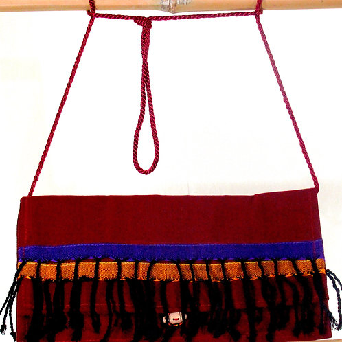 E-85 Fully-lined maroon clutch bag with woven exterior strips
