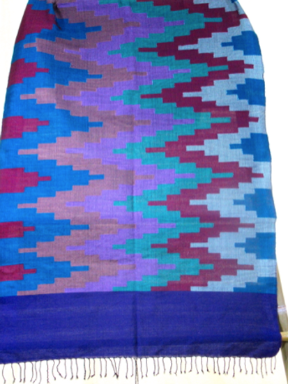 16: Large wall hanging with  teal, blue red, mauve geometric patterns