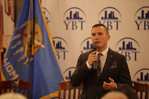 Matt Moore speaking at a Young Businessmen of Tulsa (YBT) meeting