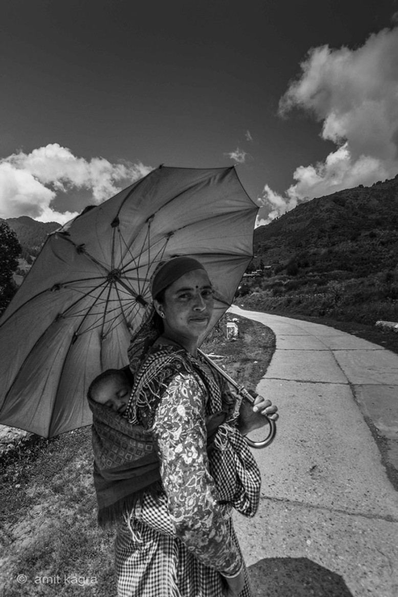 mountain woman in barot valley in himachal pradesh