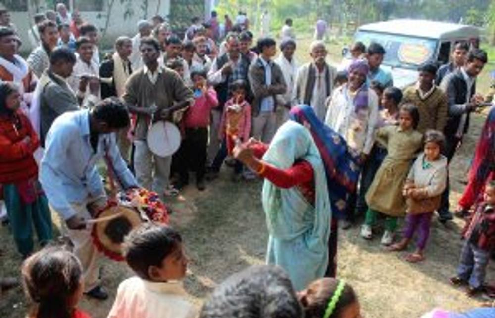 dancing women during wedding ceremony in rural india