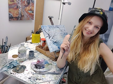Luna Smith in her art studio - winter landscape