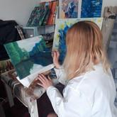 Luna Smith working on a landscape