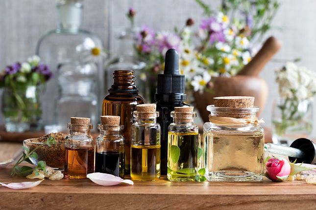 Selection of essential oils, with herbs