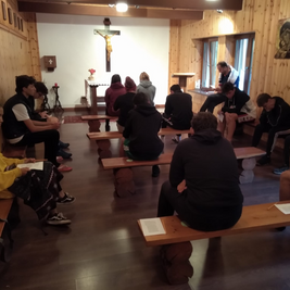 A time of prayer during a youth training session.