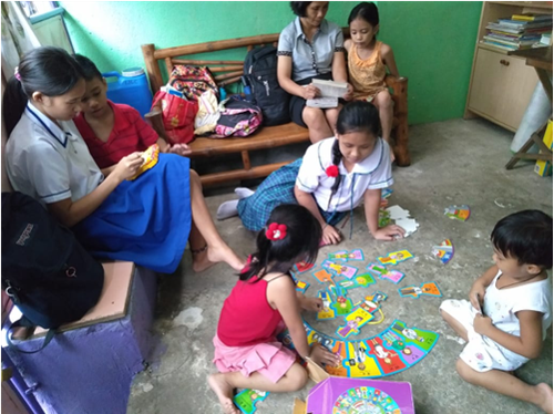 Some of the volunteers working with the children