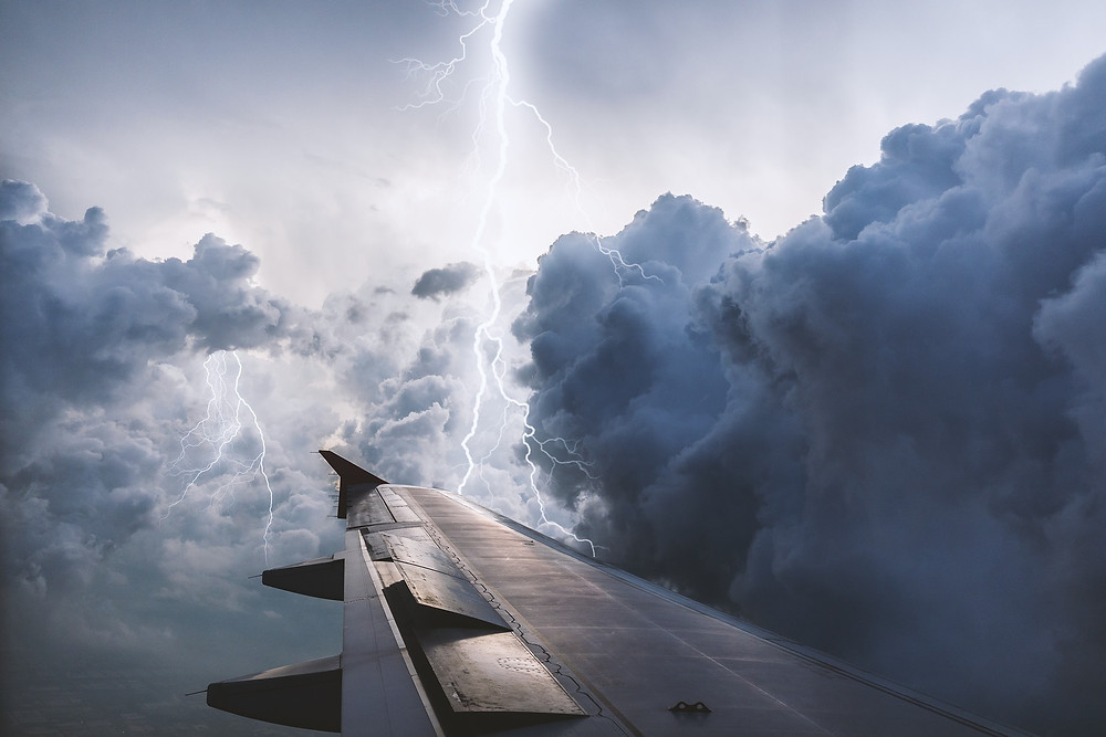 Thunderstorm over the wing of a plane