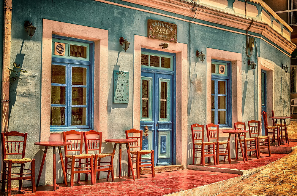 Mediterranean cafe painted in faded blue and pink