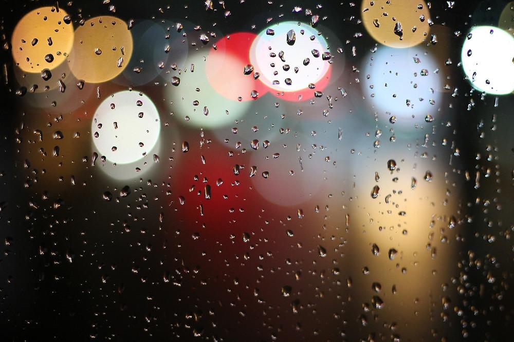 Blurred lights and rain on a window