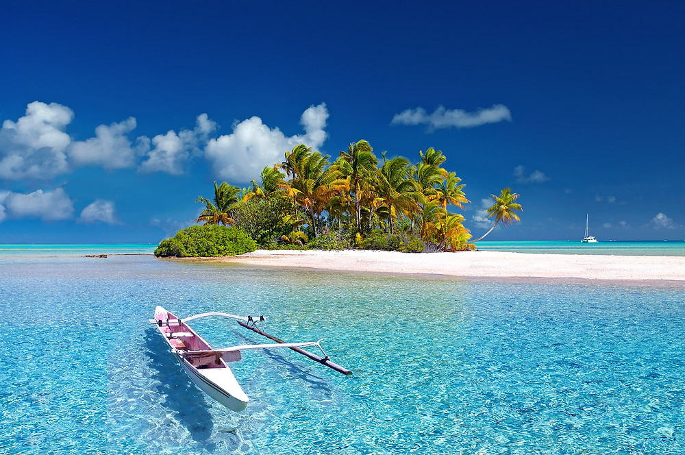 Tropical atoll with an outrigger canoe