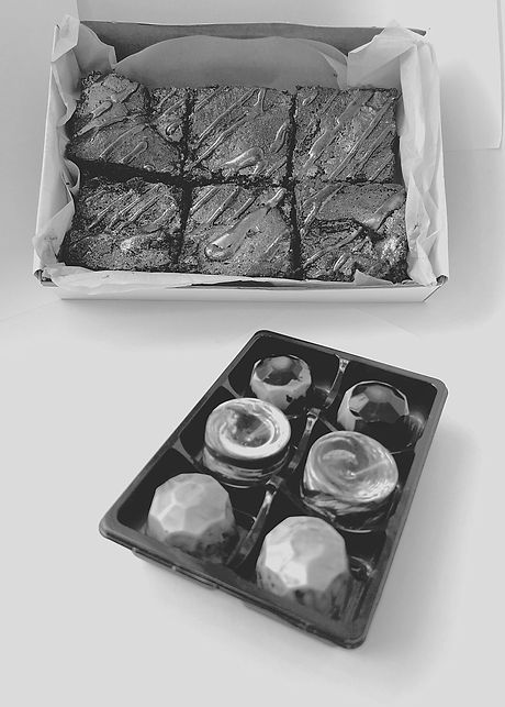 A photo displaying brownies and chocolate bon bons