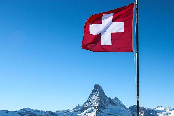 Swiss-Flag-Over-Matterhorn-Mountain-Peak