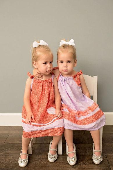 orange-pink-matching-dresses-for-twins__