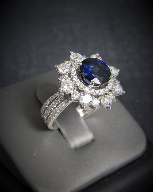 18KT White Gold Diamond And Sapphire Halo Style Ring