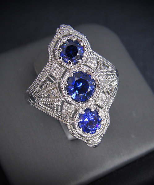 3 Stone Tanzanite, White Sapphires, & 18KT Gold Plated Sterling Silver Ring