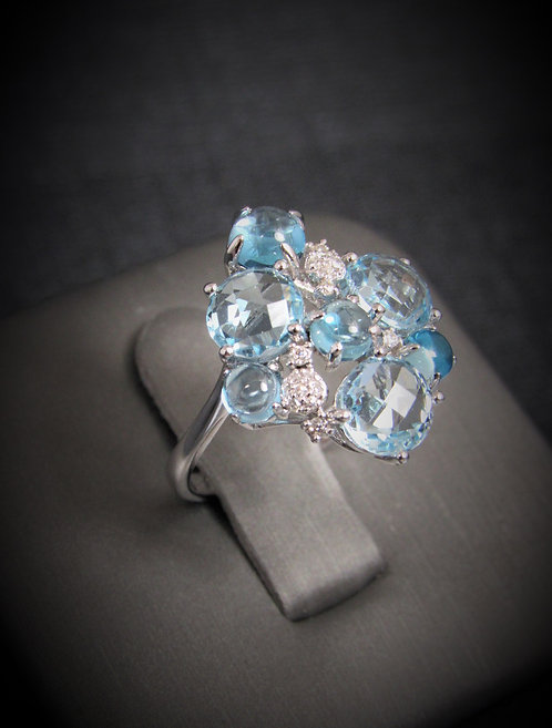 14KT White Gold Diamond And Blue Topaz Ring