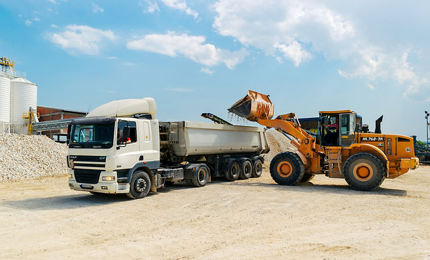 brown-loader-beside-white-cargo-truck-30