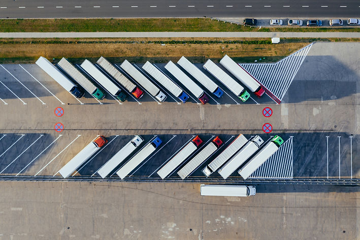 aerial-photography-of-trucks-parked-2800