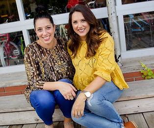 smiling women sitting on steps